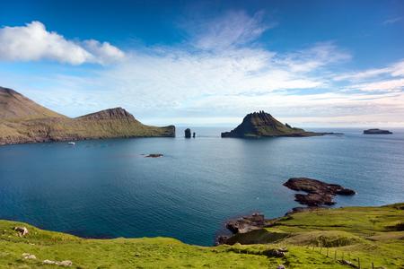 steep cliffs: Faroe Islands, Atlantic Ocean : landscape with green fields, blue sea, steep cliffs and rock stacks