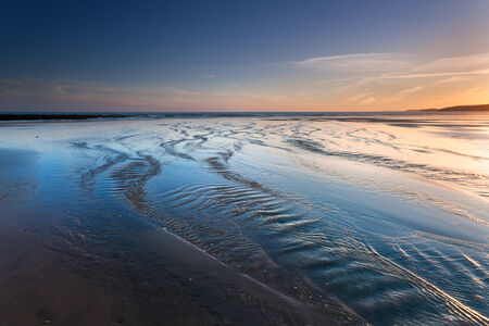 pembrokeshire: Colorful sunset on a desert beach of Pembrokeshire, West Wales