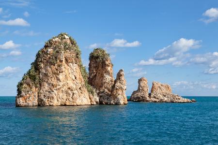 castellammare del golfo: Scopello sea stacks, Castellammare del Golfo, Sicily, Italy Stock Photo