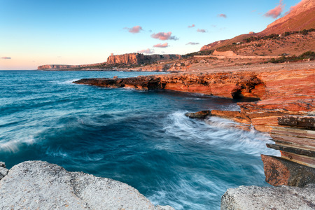 Colorful sunset on the coast of Sicily Stock Photo