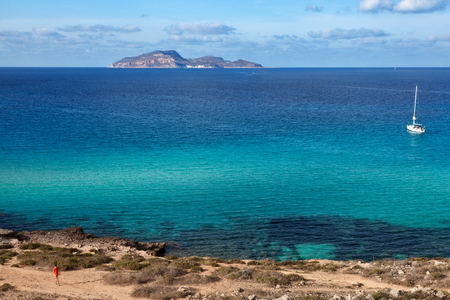 egadi: Mediterranean scenery: turquoise waters of Cala Rossa in Favignana and view of Levanzo - Sicily. Stock Photo