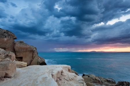 egadi: Egadi islands: sunrise on the sea, dramatic clouds Stock Photo