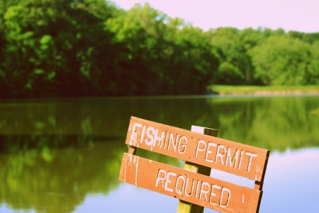 permit: Fishing Permit Required Sign on a lake