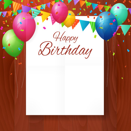 Happy birthday greeting card with balloons and flags on wood background.