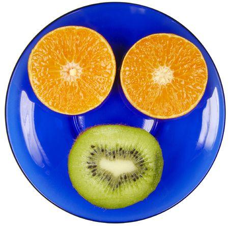 flesh colour: Fresh fruit on a dark blue plate