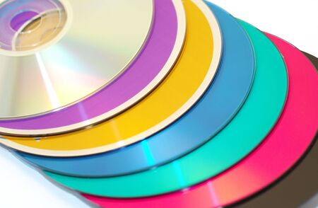 colored compact disk isolated on white photo