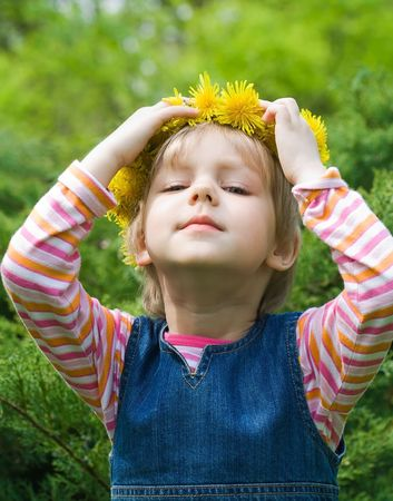 little girl with a chaplet on a head photo