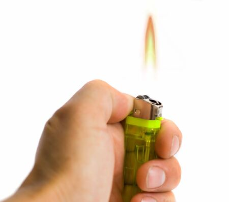 man hand holding a lighter photo