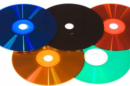 colored compact disks isolated on white photo