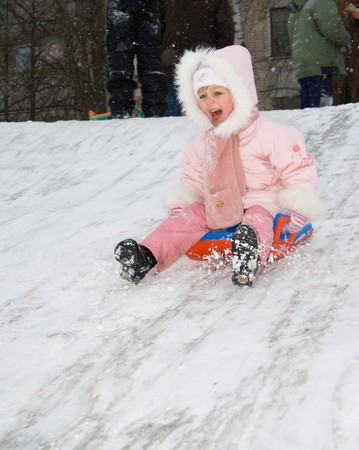 child to go to the hill on the sledge photo