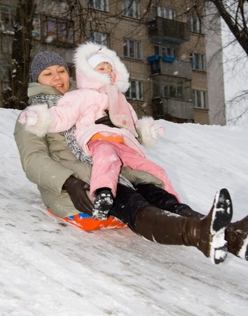 child and mother to go to the hill on the sledge photo