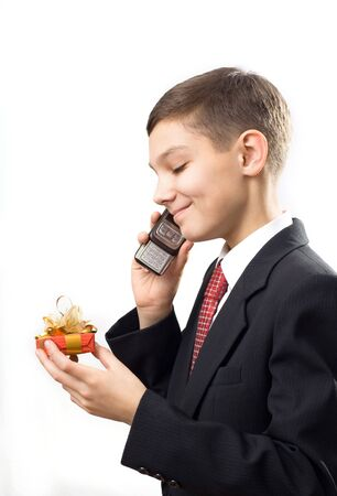 schoolboy whith phone and gift Stock Photo - 4455373