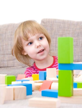 The child playing with multi-coloured cubes Stock Photo - 4893806