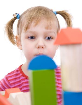 The child playing with multi-coloured cubes Stock Photo - 4893809