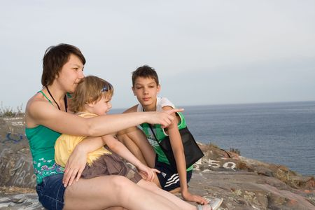 mother with children on the beach photo