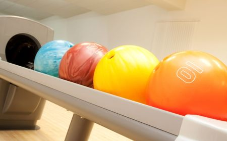 bowling balls in a row photo
