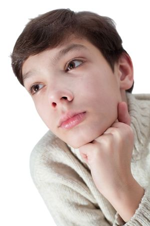 Young man with a pensive expression looking up. isolated on white background photo
