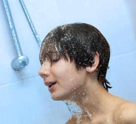 boy bathing under a shower photo