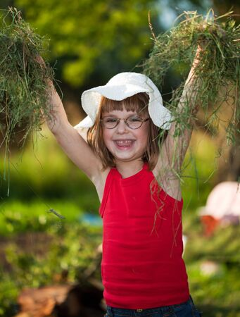 Beautiful Little Girl in the grass photo