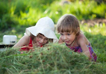 Beautiful Little Girls in the grass photo