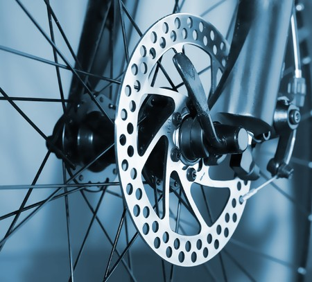 brakes: Part of Mountain Bike brake disc in close up. Stock Photo