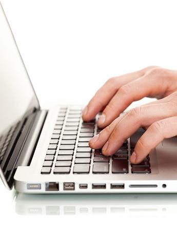 Writing on a white laptot Stock Photo - 16911305