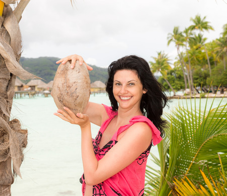Beautiful girl on exotic vacation in remote island photo