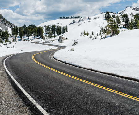 winter road: Vertical variant of the road leading into the mountains. Picture taken in Lassen National Park in California USA