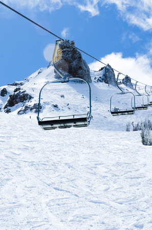Chair lifts on the mountain summint at alpine resort photo