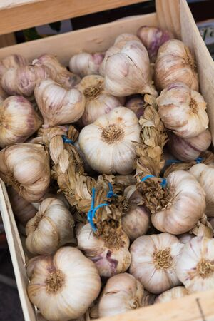 eating area: Fresh garlic for sale at farmers market