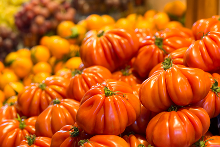 eating area: Fresh tomatoes for sale at farmers market Stock Photo