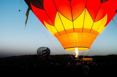 air baloon: Hot air baloon in flight in morning sky Stock Photo