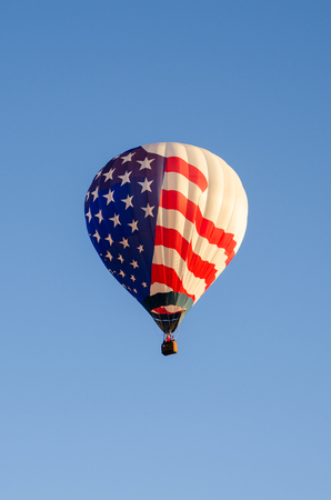 air baloon: Hot air baloon in flight in the sky