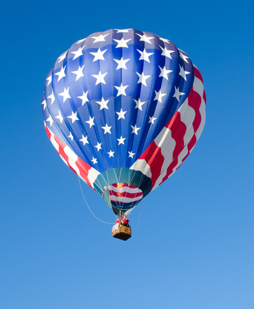 Hot air baloon in flight in the sky