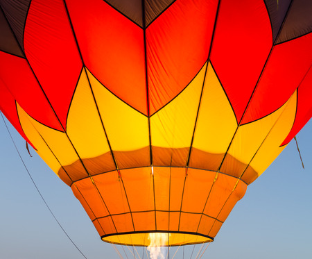 air show: Hot air baloon in flight in morning sky Stock Photo