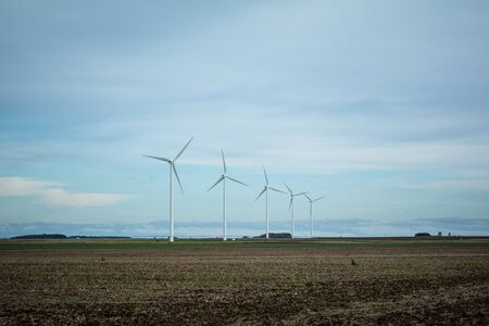 save electricity: Windmills producing the energy Stock Photo