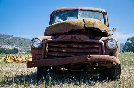Ancient  antique rusted truck in the farm field