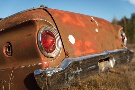 Antique car trunc in the farm field