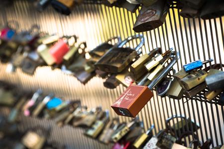 inseparable: Famous Pont des Arts bridge in Paris with love locks symbolizing couple togetherness Stock Photo