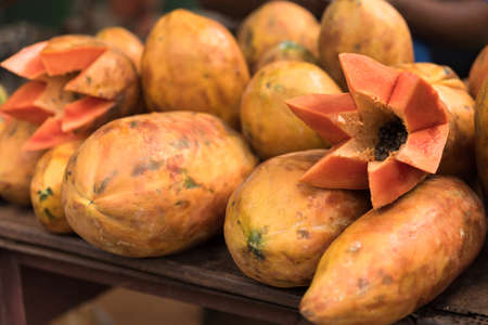 caribbeans: Fresh fruits of Papaya for sale laying on farm market stalls in Caribbeans Stock Photo