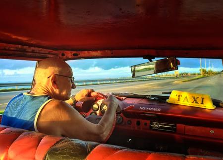 varadero: Elderly man drives taxi in Varadero