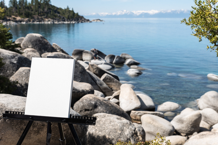 canvass: Easel with Blank canvass on Lake Tahoe shore Stock Photo