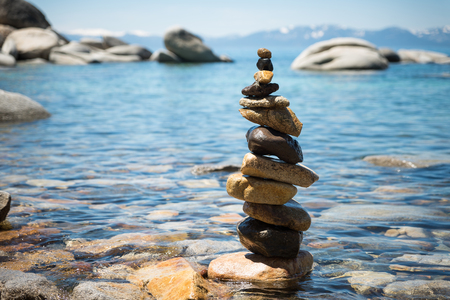 lake tahoe: Rock pyramid with Lake Tahoe on the background Stock Photo