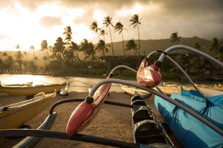 outrigger: Polynesian outrigger canoe on the beach in the evening