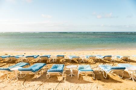 Sunbeds on sand beach welcome you Stock Photo