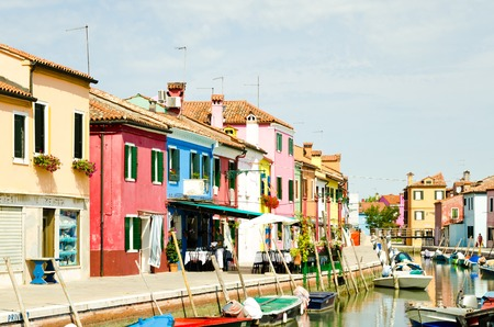 Colorful houses along canals in Burano near Venice in Italy
