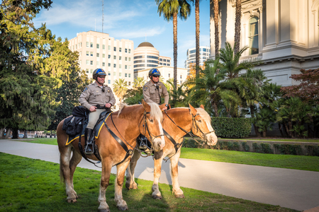 Sacramento, CA, USA - November 13, 2016: Equestrian Police guards stand by State Capitol Building Editorial