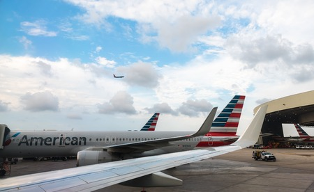 buisiness: Aeroplanes of American Airlines in the hub Editorial