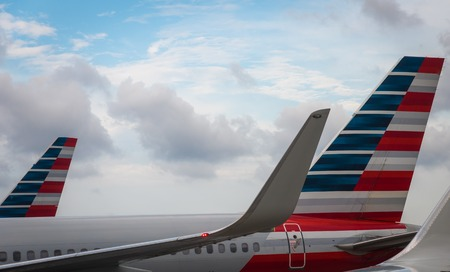 Aeroplanes of American Airlines in the hub Editorial