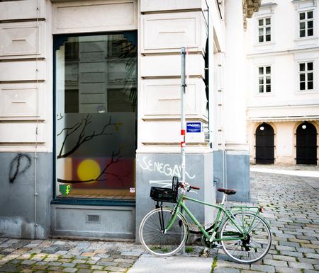 Bike parked on typical Vienna  street